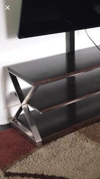 Tv stand with mounting hardware. TV not included!