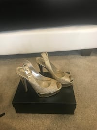 pair of gray peep-toe platform stilettos 12 km