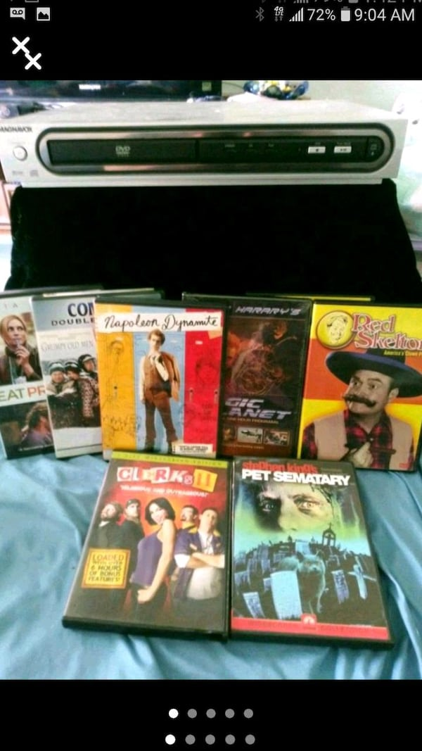 DVD Player and 8 DVD Movies. ec75f66c-147f-42ed-82ce-eabf01787d23