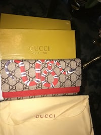 brown and black Gucci leather wallet Saint Louis, 63126