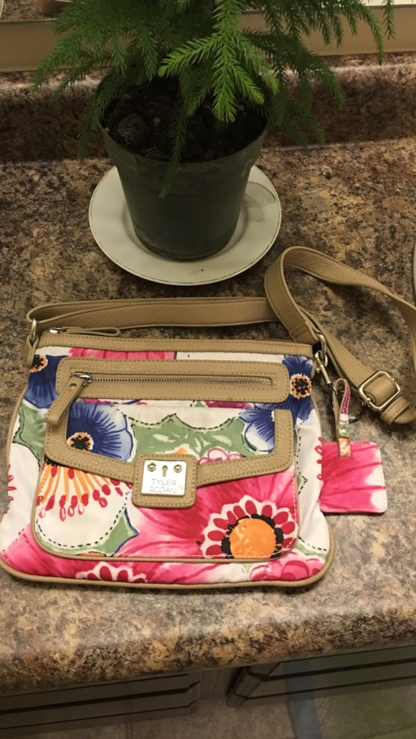 be5ebabebaea Used brown, white and red floral sling bag for sale in Indianapolis - letgo