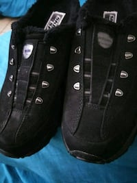 pair of womens black sports sketchers slip on's 6. San Antonio