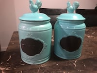 Two blue -and-teal ceramic canisters Delta, V4C