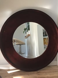 "Dark brown wood mirror. 38"" Diameter"