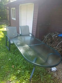 Patio table in good condition with 4 chairs but al Bloomingdale, 60108