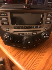 2005-7 Honda Coupe 6 changer Radio with Code to unlock.