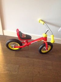 toddler's red and yellow bicycle 3491 km