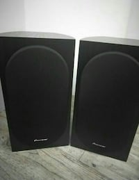 pair of black Pioneer audio speakers