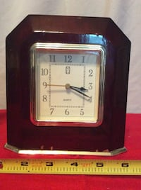 Paul Sebastian mantle clock, made of wood,battery operated Shelby, 35143