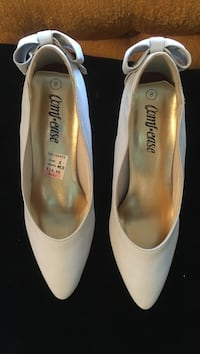 Pair of beige heels with bow on back size 8