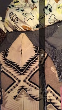 beige, black, and white aztec knit zip-up jacket