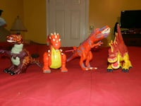 four red and orange T-Rex action figures