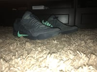 pair of black-and-green Nike basketball shoes New Westminster, V3M 5K5
