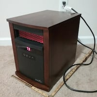black and brown cabinet heater