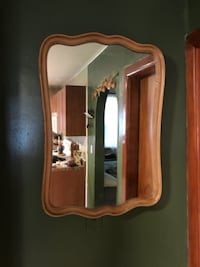 brown wooden framed wall mirror null