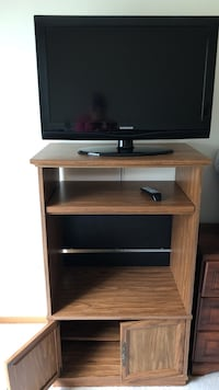 black flat screen TV with brown wooden TV stand Apple Valley, 55124