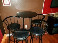 Pub table with 4 chairs. Black Cypress, 77429