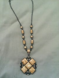 gold-colored and black beaded necklace Las Vegas, 89102