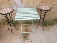 2 pier one plant stands and garden table North Las Vegas, 89030
