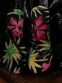 pair of black-green-and-pink floral print rubber f