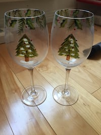 two clear-and-green pine tree graphic wine glasses Kirkland, H9J 3A2