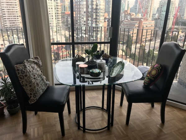 Used Glass Dining Table With A Black Bottom And Two Leathers Chairs For Sale In Vancouver