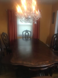 Real wood dining table set with 6 chairs.  43 km
