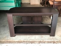 Brown wooden entertainment stand