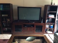 Brown wooden tv hutch with flat screen television Minnetonka, 55305