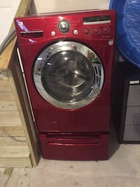 Red lg front-load clothes washer 148 mi