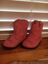 pair of red-and-black leather cowboy boots