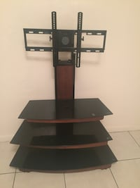 Like new glass tv stand with mount  921 mi