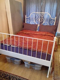 brown floral bed sheet with white metal headboard 21 km