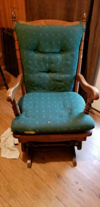 green and brown wooden armchair