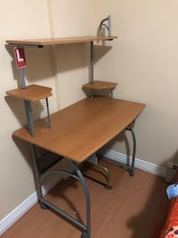 Brown wooden computer desk with gray metal base new no scratch  Surrey, V3W 1R5