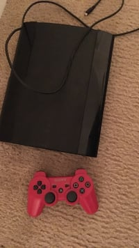 black and red Sony PS3 game console