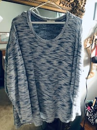 Warm blue tunic top , slip on . Not bulky .