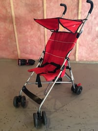 baby's red and gray lightweight stroller