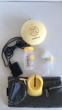 White and yellow medela breast pump Toronto, M8Y 1H1