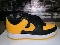 Pair of black-and-yellow nike sneakers Silver Spring, 20902