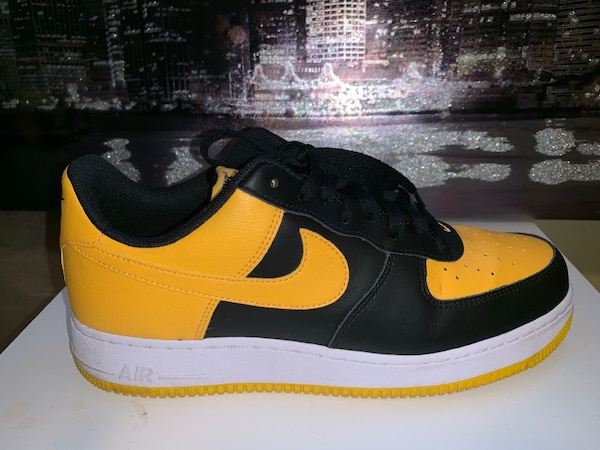 Pair of black-and-yellow nike sneakers