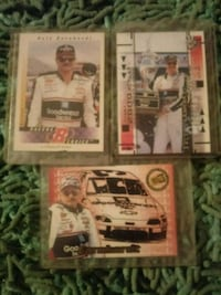 four assorted-color trading cards 306 mi