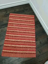 Red mat from Pier 1. Easy to wash. Pickering, L1X 2V5