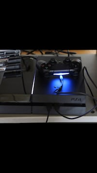 black Sony PS4 console with controller Irvington, 07111