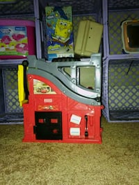 toddler's gray, red, and yellow Fisher-Price Disne
