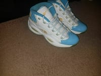 pair of teal-and-white Reebok basketball shoes