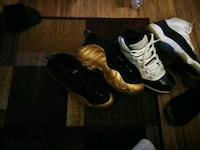 pair of black-and-white Nike Foamposite shoes 26 mi