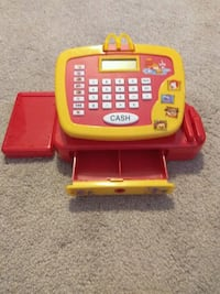 yellow and red McDonalds cash register toy