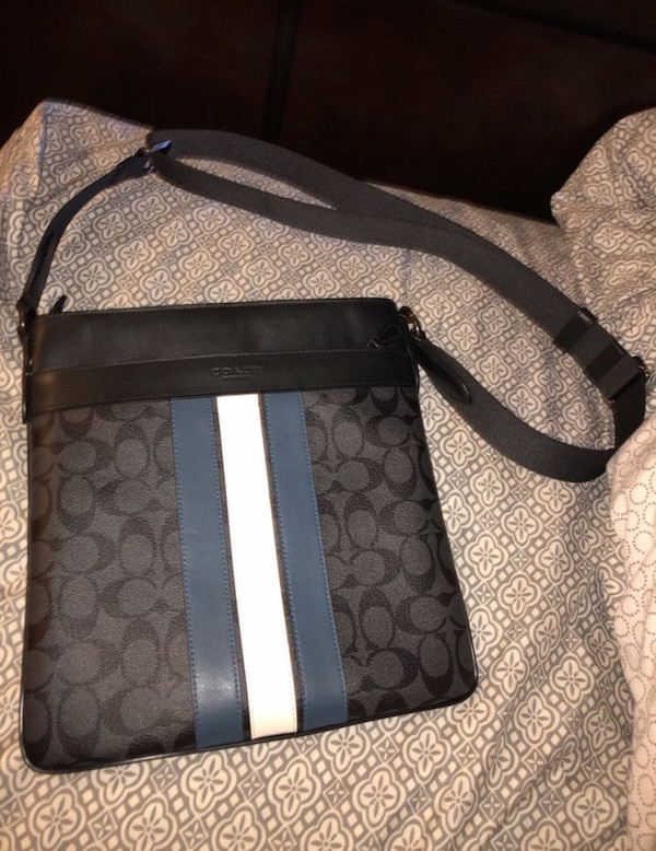 black and gray Coach sling bag