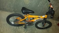yellow and black full suspension bicycle